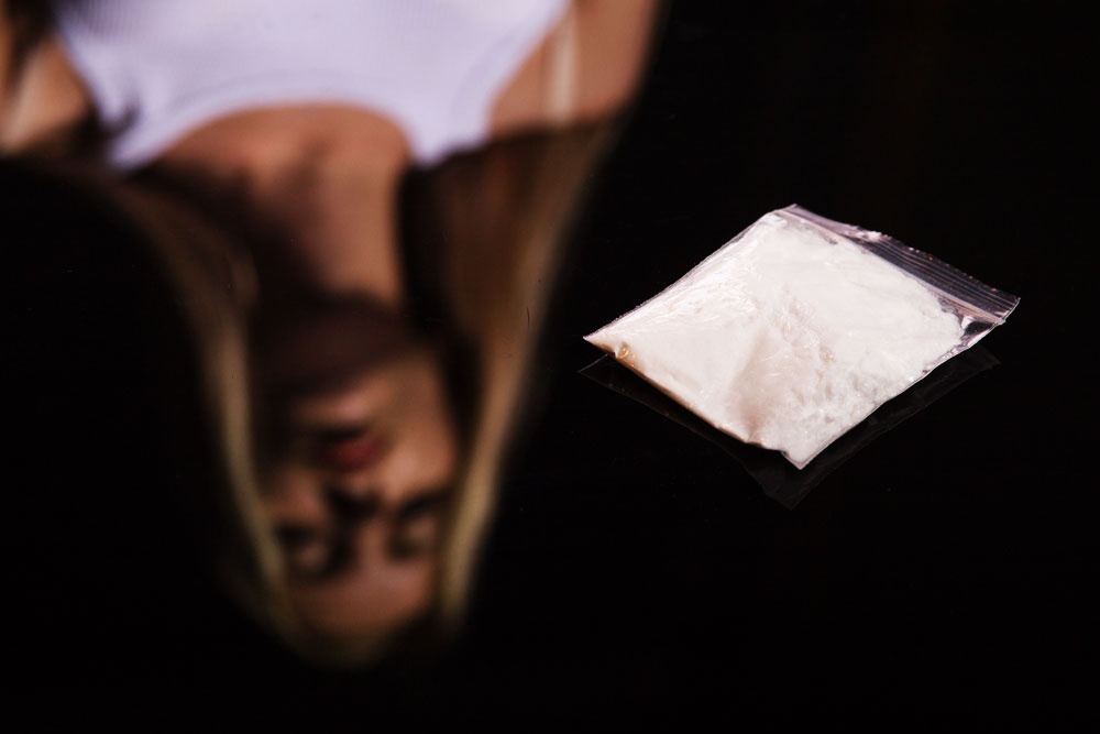 Why are women more likely to get hooked on cocaine?