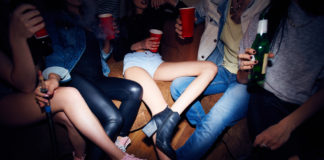 How are underage drinkers influenced by alcohol ads?